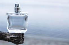 Bottle of modern perfume. On blue background Stock Images