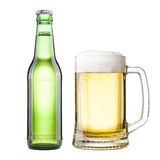 Bottle and mug with beer Royalty Free Stock Image
