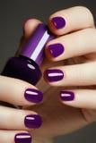 Bottle of nail polish. Beauty hands. Trendy stylish colorful nai Stock Photos