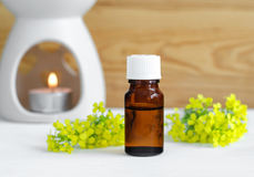 Bottle of natural essential oil and lamp for aromatherapy Royalty Free Stock Photography