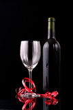 Bottle a nd glass of red wine Stock Photo