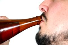 Bottle neck 6. Isolated image of a beer being drunk Stock Images