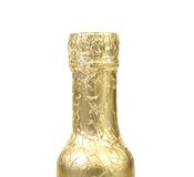 Bottle neck wrapped with gold foil. Royalty Free Stock Images