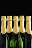 Bottle necks of Champagne bottles on black background Stock Photos