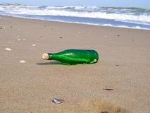 Bottle with a note has beaten a wave Stock Image