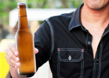 Bottle Of Beer In Hand Stock Photography