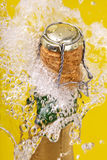 Bottle Of Champagne, Cork And Splashing Royalty Free Stock Photography