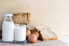 Free Bottle Of Milk, Eggs, And Bread On The Wooden Table. Royalty Free Stock Photo - 119971305