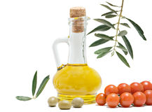Bottle Of Olive Oil, Tomatoes, And Olive Fruits Stock Image