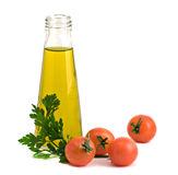 Bottle Of Olive Oil, Tomatoes, And Parsley Stock Photo