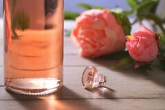 Bottle Of Pink Rose Wine And Spring Flowers Royalty Free Stock Photos