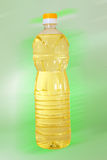 Bottle of oil. On green background Stock Photo