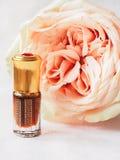 Rose perfumed oil. Arab perfume in mini bottles. Bottle of oil agarwood tree. Rose perfumed oil royalty free stock photo