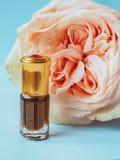 Rose perfumed oil. Arab perfume in mini bottles. Bottle of oil agarwood tree. Rose perfumed oil stock photos