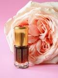 Rose perfumed oil. Arab perfume in mini bottles. Bottle of oil agarwood tree. Rose perfumed oil stock photography