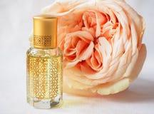 Rose perfumed oil. Arab perfume in mini bottles. Bottle of oil agarwood tree. Rose perfumed oil royalty free stock photos