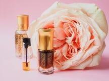 Rose perfumed oil. Arab perfume in mini bottles. Bottle of oil agarwood tree. Rose perfumed oil stock photo