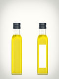 Bottle with oil isolated on a white background Stock Images