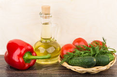 Bottle with oil, paprika and tomatoes, cucumbers, dill Royalty Free Stock Images