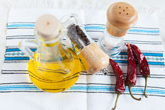 Bottle oil, spices and hot peppers Stock Photo
