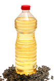 Bottle with oil and sunflower seeds Royalty Free Stock Photo