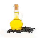 Bottle with oil and sunflower seeds Stock Images