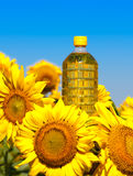 Bottle of oil with sunflowers Stock Photos