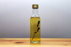 Bottle of oil. On the table Royalty Free Stock Photos