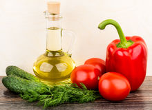 Bottle of oil, tomatoes, cucumbers, paprika and dill Royalty Free Stock Photos