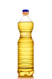 Bottle with oil. Transparent plastic bottle with oil closeup  on white background Royalty Free Stock Images
