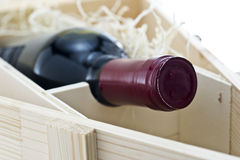Bottle of old red wine in gift wooden box Stock Photography