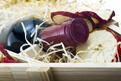 Bottle of old red wine in gift wooden box Royalty Free Stock Photography