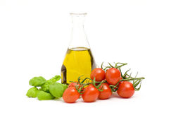 Bottle of olive oi, tomatoes and basil Royalty Free Stock Images
