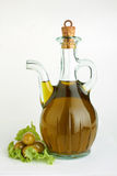 Bottle of olive oil. Branch with olives and a bottle of olive oil on white Stock Photo