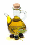 Bottle of olive oil. And fresh olives on white background Royalty Free Stock Images
