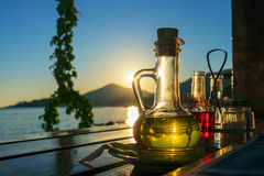 Bottle with olive oil on a background of sea sunset Stock Images