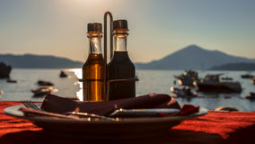 Bottle with olive oil on a background of sea sunset Stock Image