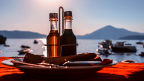 Bottle with olive oil on a background of sea sunset Stock Photo