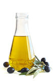 Bottle of olive oil. And black olives isolated on white background Royalty Free Stock Photos