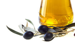 Bottle of olive oil. And black olives isolated on white background Stock Photos