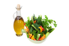 The bottle of olive oil and bowl of fresh vegetables Royalty Free Stock Image