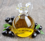Bottle of olive oil. Branch with olives and a bottle of olive oil Stock Images