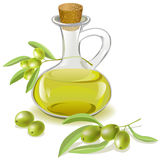Bottle of olive oil and a branch with olives Royalty Free Stock Images