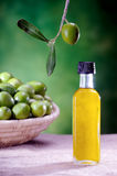 Bottle of olive oil on canvas Stock Photo