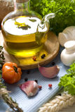 Bottle of Olive oil and condiments Stock Images