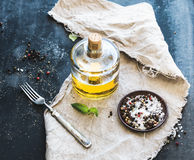 Bottle of olive oil with fresh basil and spices Royalty Free Stock Image