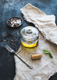 Bottle of olive oil with fresh basil and spices Royalty Free Stock Photo