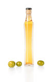 A bottle of olive oil and fresh green olives. Stock Images
