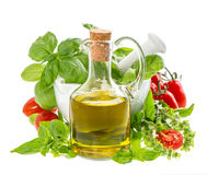 Bottle of olive oil with fresh mediterranean herbs Stock Photos