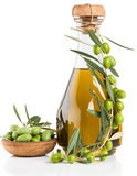 Bottle of olive oil with fresh olives Royalty Free Stock Images